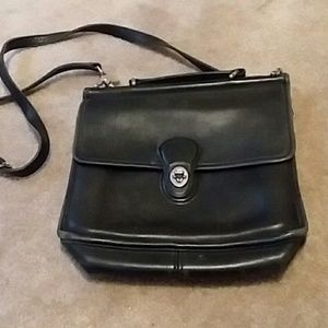 Black leather purse with gold hardware